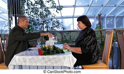 Drink Wine - Mature couple having dinner in a nice and...