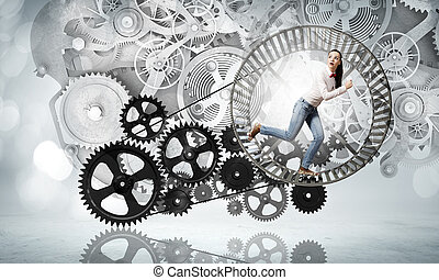 Always busy at work - Young businesswoman running in wheel...