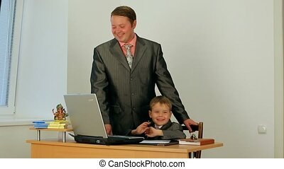 Current Generation - Father and son use a laptop