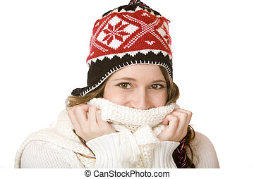 Young happy smiling woman with cap holding scarf over mouth