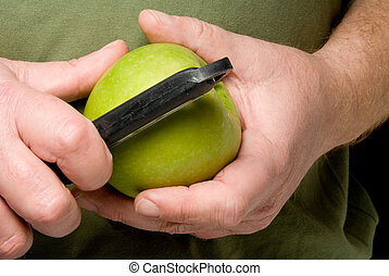 Peeling an Apple - A person in the process of Peeling an...