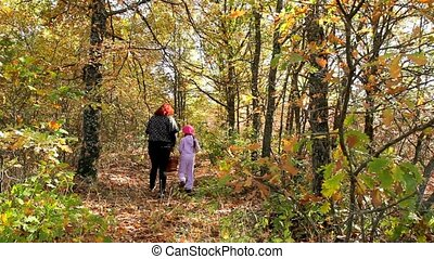 Walking Through The Autumn Woods - Mother with her daughter...