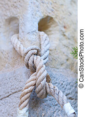 Knot in a rope in a wall hole