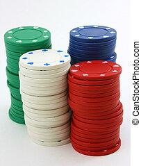 Stacks of poker chips green, red, white, blue