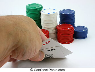 Poker player views pocket pair aces poker, chips