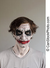 Halloween face painting - Scary man with face painting Joker