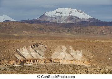 Active Volcano on the Altiplano - Snow covered peak of the...