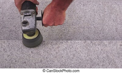 Man with grinder polishing stairs - Man with grinder...