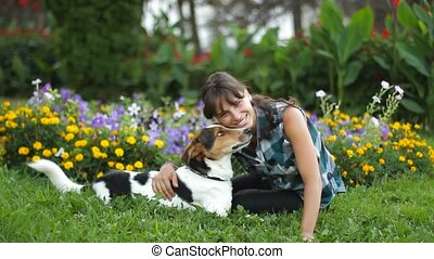 Woman Relaxing With Dog - A girl with her dog resting in a...