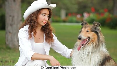 Presentation Of Dogs - Woman trains dog in a park.