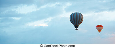 Air balloons in blue sky - Two air balloons in blue sky with...