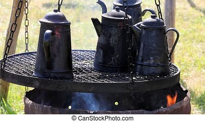 Old tea kettles over a fire at Far-west camp