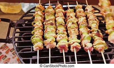 BBQ barbecuing skewers - Grilled gourmand chicken skewers...