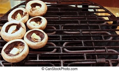 Mushrooms on BBQ - Mushrooms are cooking over electric hot...