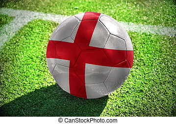 football ball with the national flag of england lies on the...
