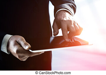 businessman holding touch pad - businessman holding and...