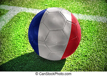 football ball with the national flag of france lies on the...