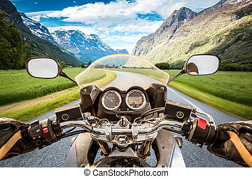 Biker First-person view - Biker driving a motorcycle rides...