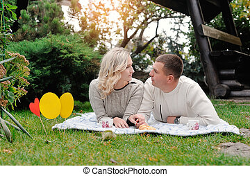 man and woman on picnic in summer