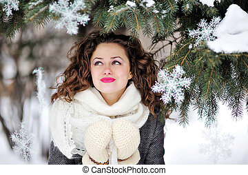 portrait of a beautiful woman in winter knitted mittens
