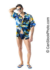 Handsome, athletic young man with open shirt and swimming suit