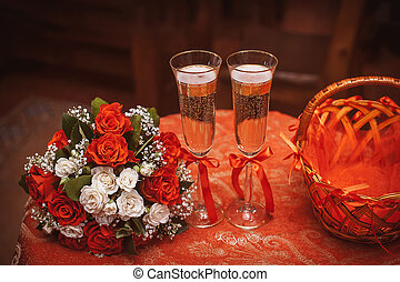 Two wedding glasses with champagne