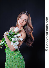 portrait of beautiful girl with white tulips