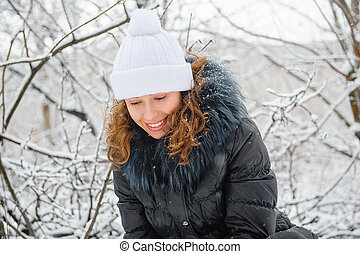 young woman in winter knitted hat