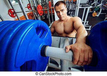 masculinity - Professional bodybuilder in a sport gym club....