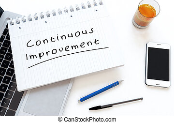 Continuous Improvement - handwritten text in a notebook on a...