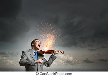 Violin player - Young emotional businessman playing with...
