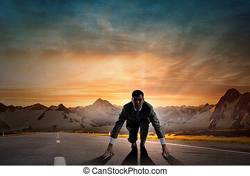 Ready to run - Young determined businessman standing in...