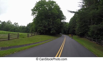 Passing Cyclists Blue Ridge Parkway - A camera is mounted to...