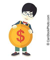 Asian Businessman holding a big coin - An asian businessman...