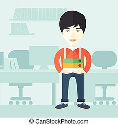 Asian man standing inside his office - An asian man standing...