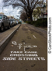 Crossing Road Sign Painted on Ground - Painted road sign on...