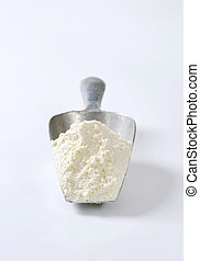 Scoop of wheat flour - Metal scoop of finely ground flour