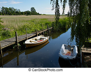 Tranquil scene small dinghy boats in a river