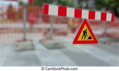 Street is under construction. - Multiple warning signs...