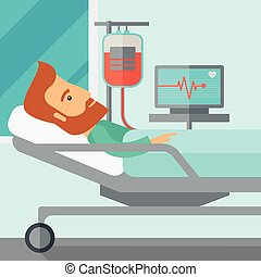 Patient in hospital bed being monitored - A caucasian...