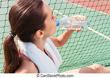 Sportswoman drinking water - Best way to stay fit Pleasant...