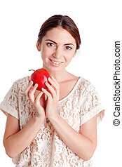 Pleasant young girl apple - Lets taste it. Pretty young girl...