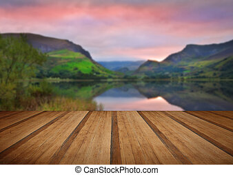 Llyn Nantlle at sunrise looking towards mist shrouded Mount...