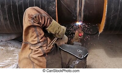 Manual Metal Arc welding - Welder is welding pipeline to...