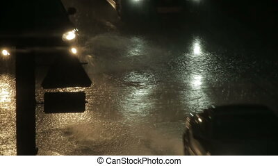 Cars on wet road in rain - Cars on wet road at night in the...