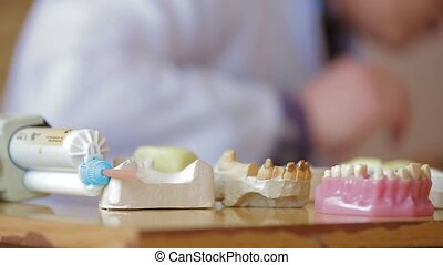 Dental Prostheses - Dentist demonstrating dental prostheses....