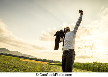 Thankful Man in the Field Raising Arm for Success - Thankful...