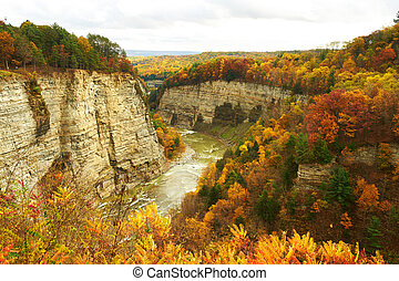 Autumn scene of waterfalls and gorge - Autumn scene...
