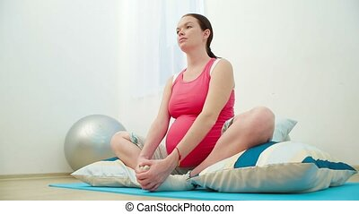 Pregnant In Lotus Pose - Pregnant is sitting in lotus pose...