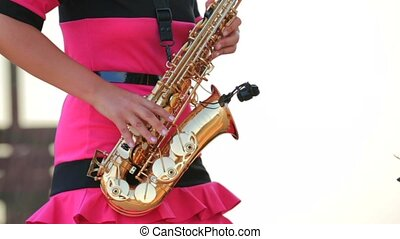 Woman Playing The Saxophone Close-Up - Close-up shot of a...